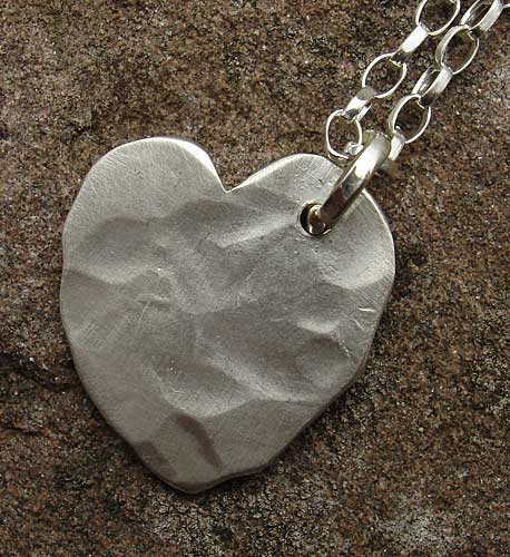 Beaten silver heart necklace