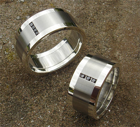 Black diamond wedding rings in stainless steel