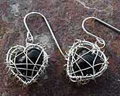 Caged heart shape drop earrings