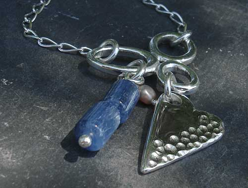 A Celtic necklace for women with a polished silver heart