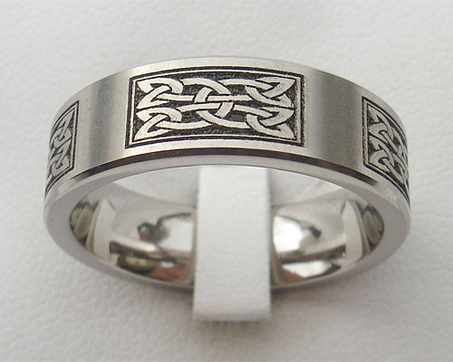 Titanium Celtic ring with a Celtic knot in panels