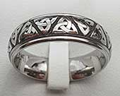 Titanium ring engraved with a Celtic Trinity knot pattern