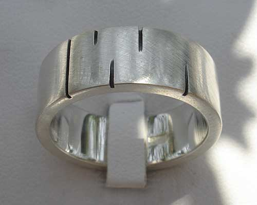 Contemporary etched silver wedding ring