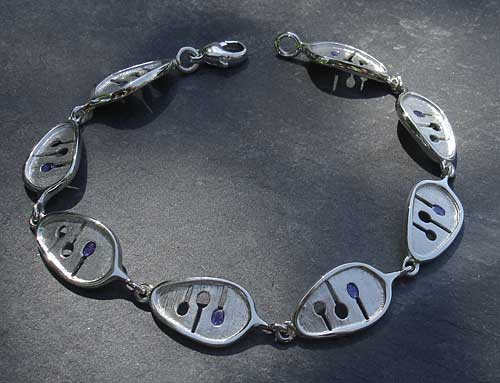 A Celtic bracelet made from sterling silver with enamel detail