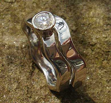 Contemporary silver wedding rings set