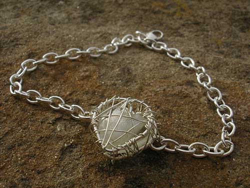 Designer silver heart bracelet for women