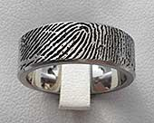 Titanium ring with a personalised fingerprint