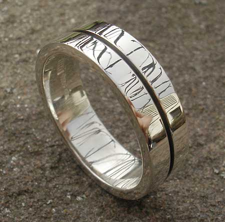 Flat contemporary silver wedding ring