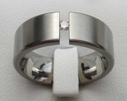 Flat tension set titanium engagement ring