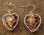 Gold caged heart drop earrings