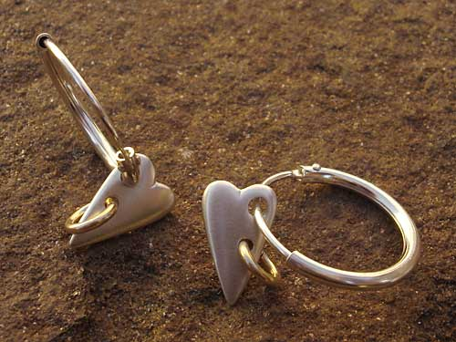 Gold and silver heart earrings