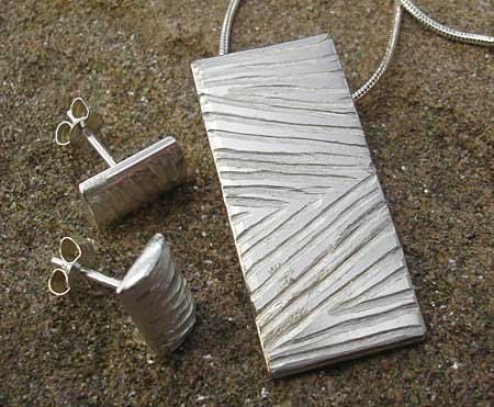 Handmade silver earrings and necklace