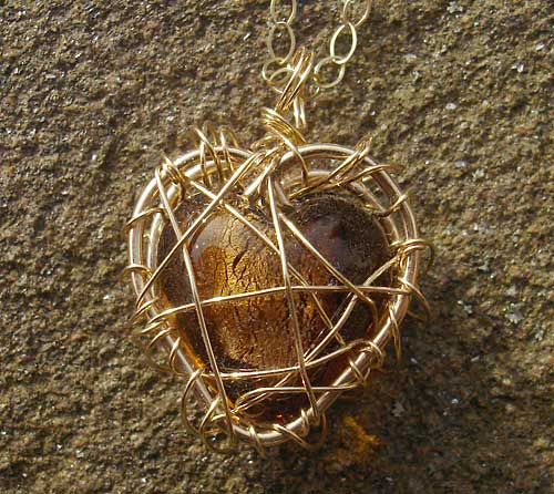 Womens Gold Caged Heart Necklace