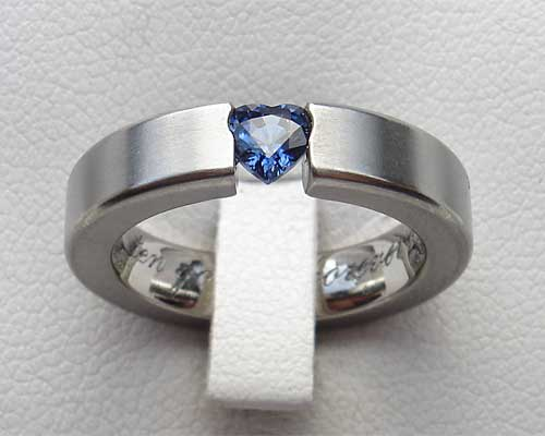 Engagement ring with a heart shaped sapphire
