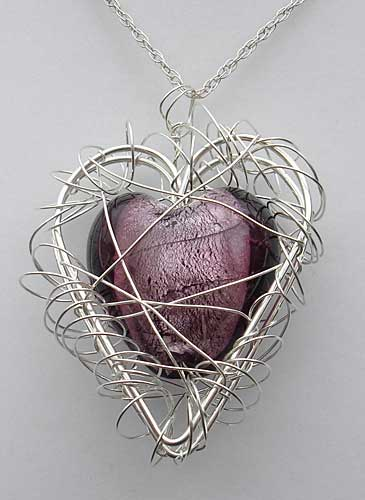 Womens Caged Heart Silver Necklace