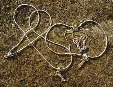 Silver heart bracelet and necklace