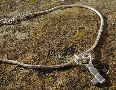 Silver bracelet with a key in a heart shape