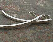 Long hammered silver earrings