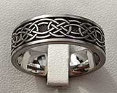 Celtic titanium ring engraved with a Celtic knot design