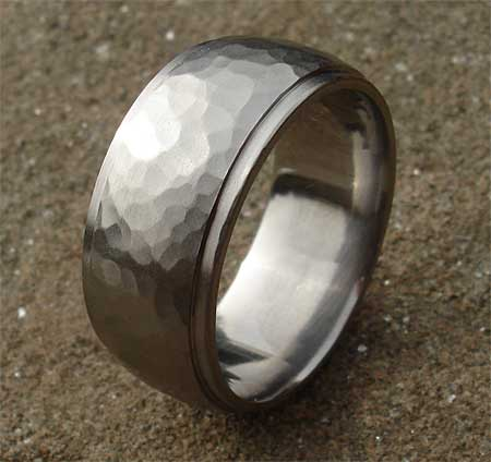 Wedding ring in hammered titanium