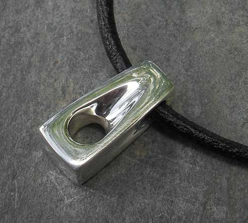 Men's handmade polished silver pendant