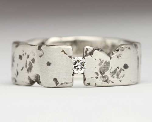 Men's silver diamond ring with a rocky texture