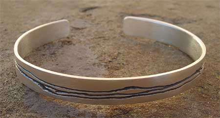 Mens and womens silver bracelet