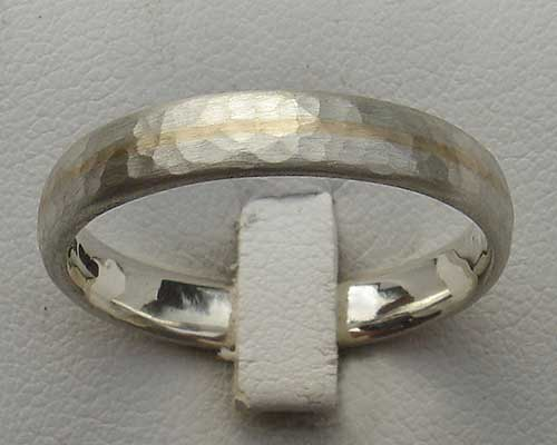 Narrow silver and gold wedding ring
