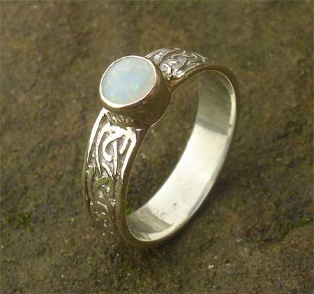 Celtic engagement ring in with an opal