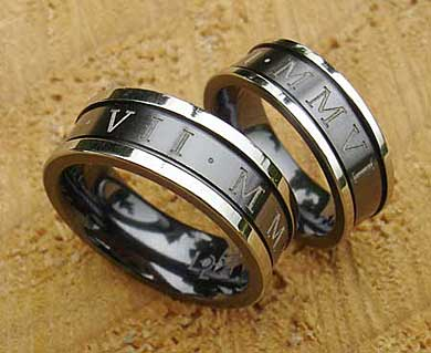 Outer engraved two tone wedding rings