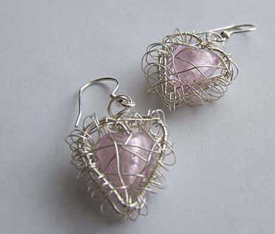 Pink heart shape cage earrings