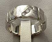 Diamond silver ring with a rugged texture