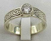 A Scottish Celtic engagement ring shown here in 9ct white gold and set with a sparkling 45pt white diamond