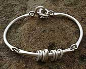 Unusual womens silver bracelet