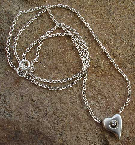 Silver heart and diamond necklace