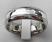 Titanium wedding ring with a silver inlay
