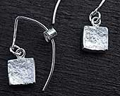 Silver hook earrings in the shape of a key with a heart shape