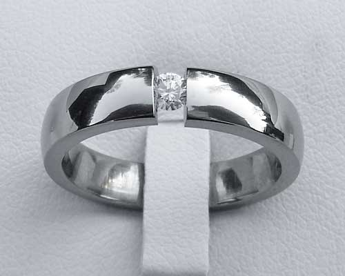 Tension set diamond titanium engagement ring