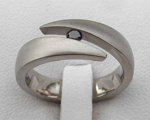 Unusual black diamond titanium engagement ring