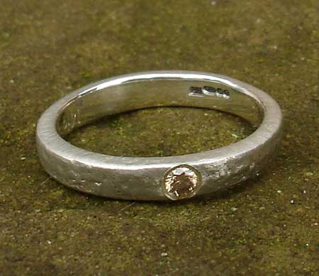 Unusual diamond silver engagement ring