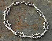 Unusual mens silver bracelet