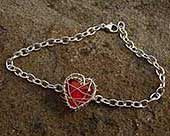 Unusual red heart silver bracelet