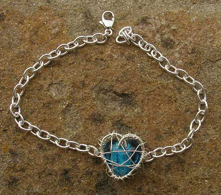 Unusual silver heart bracelet for women