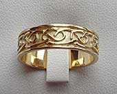 Gold Celtic wedding ring with a Celtic knot pattern