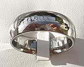 Domed titanium wedding ring with a gold inlay