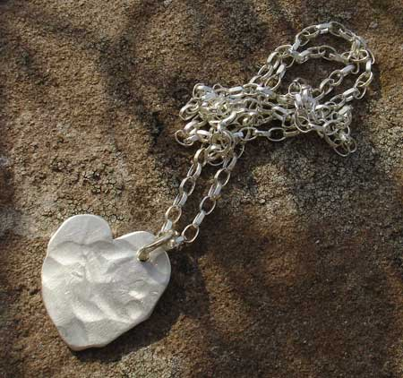 Women's beaten silver heart necklace