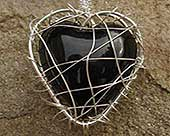 Womens black heart silver necklace