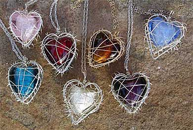 Women's caged heart silver necklaces