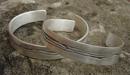 Womens contemporary silver cuff bracelets