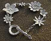 Women's contemporary silver flower bracelet